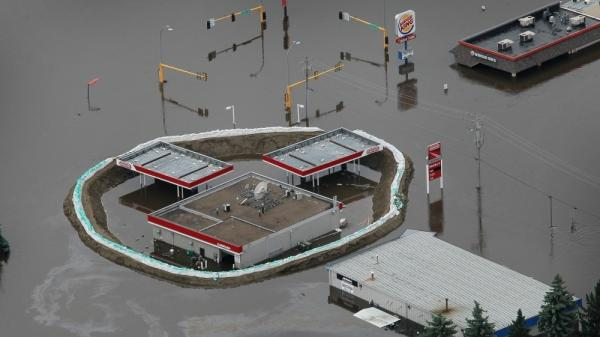 Businesses are surrounded by floodwater as the Souris River crests as seen from the air on Sunday in  Minot,  North Dakota. The Souris River surpassed its 1881 record  level of 1,558 feet above sea level and flooding estimated 4,000 homes  in the city.