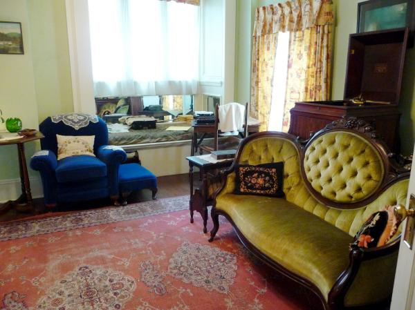 "<em>Gone With The Wind</em> was written on a wooden desk, angled in a corner of Mitchell's parlor. A replica of the desk, seen in the far corner of the photo above, is on display at Mitchell's apartment. <strong><a href=""http://bit.ly/jn9snl"">Click to see the actual desk,</a></strong> which is on display at the Atlanta History Center."