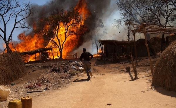 A fire breaks out in a gold mining village in the Bocaranga region of the Central African Republic in January. The possibility of a lucky strike has many farmers abandoning their fields for the mine, but aid workers express concern over poor conditions.