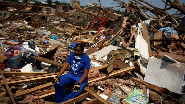 April 30, 2011: In Tuscaloosa, Ala., LaTia Cobbs sat in the rubble of her destroyed home following the massive tornado that swept through the city three days earlier.
