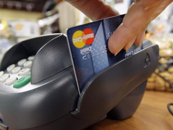 The average fee in America for each card swipe is 44 cents — the highest in the world.