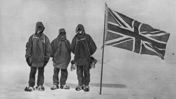 Irish explorer Ernest Shackleton and two members of his expedition team pose with a Union Jack within 111 miles of the South Pole in 1909.