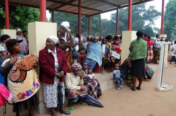 Women wait outside the maternal-child health clinic in Macia. Women who come to the clinic for prenatal care will automatically be tested for HIV.