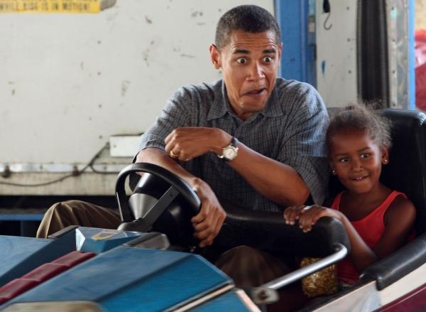 While campaigning for president in 2007, Barack Obama, then a senator from Illinois, drove a bumper car with his daughter Sasha at the Iowa State Fair.