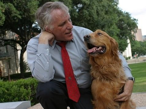 Guide Dogs Acting President Morgan Watkins with his guide dog, Will.