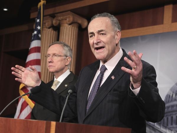 Sen. Chuck Schumer, D-NY, speaks to reporters as Senate Majority Leader Harry Reid listens at left.  As debt talks stalled this week, Schumer accused Republicans of wanting the economy to fail. (AP/J. Scott Applewhite)