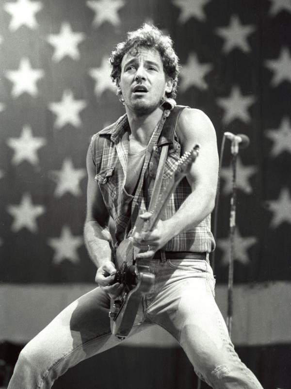 Bruce Springsteen, the NPR audience favorite, plays in front of the flag, circa 1984.