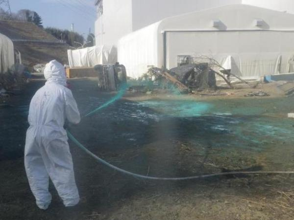 Workers at the Fukushima Dai-ichi nuclear power plant spray a substance to help reduce dust on April 1. Experts say it's likely that workers at the plant could have reduced the severity of the accident if they had made different decisions during the crisis.