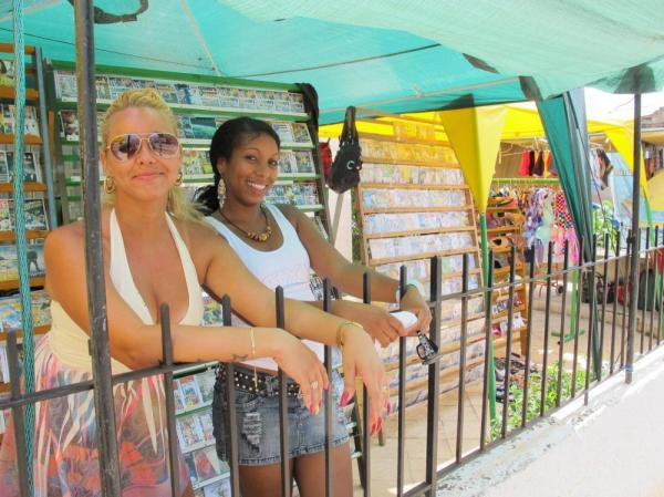 Ivelis Ramos (right) was laid off from her state job as a bookkeeper last year and now runs a makeshift store in Havana's Miramar neighborhood. Restrictions on privately-owned businesses are beginning to relax under Raul Castro, Fidel Castro's brother.