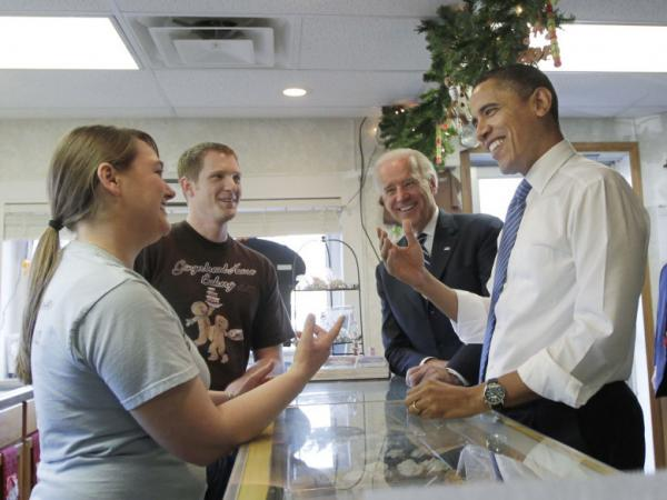 President Barack Obama, joined by Vice President Joe Biden, visit the Gingerbread House Bakery in downtown Kokomo, Ind., during a visit to tout the city as a success story of the Recovery Act in November 2010. Owners, Lauren Gaines and her husband Matt, left, received a $140,000 loan from the economic stimulus to buy the former doughnut shop.