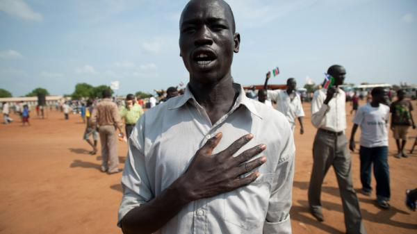 A South Sudanese man sings the new national anthem.
