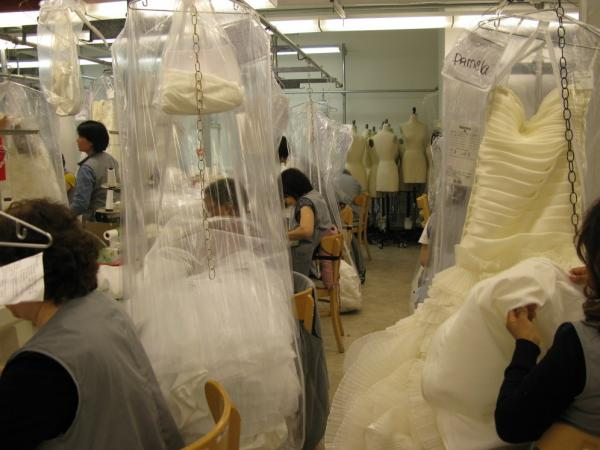Seamstresses sew wedding dresses at Kleinfeld Bridal, one of the world's largest bridal emporiums. Brides that call because of the new law probably won't  have an appointment for another month.