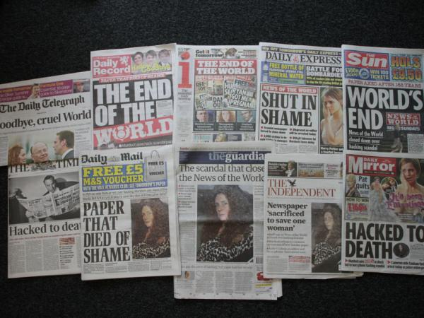 Various front pages of London newspapers report on the closing of the national tabloid newspaper <em>News of The World</em> in London, England.
