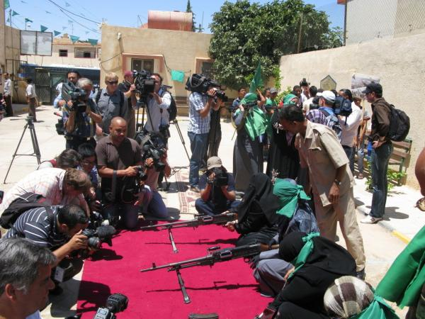 Reporters outnumber women who are showing their weapons expertise at a small  pro-Gadhafi demonstration in the mountain city of Gharyan, a key target for rebels who are trying to advance  toward Tripoli.