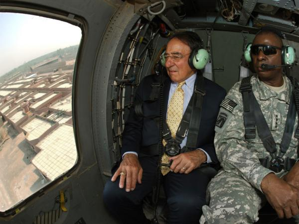 Secretary of Defense Leon Panetta (left) sits with Lt. Gen. Lloyd Austin, the top U.S. commander in Iraq,  as they fly in a Black Hawk helicopter over Baghdad on Monday.