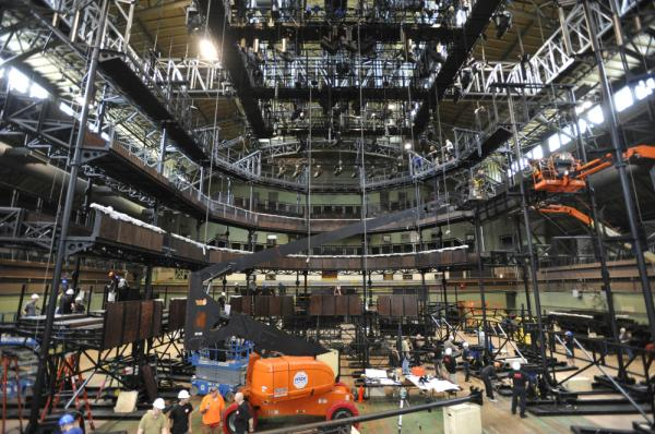 Inside the Park Avenue Armory in New York City, a construction crew assembles a replica — moved to New York in 46 shipping containers — of the Royal Shakespeare Company's main theater in Stratford-Upon-Avon.