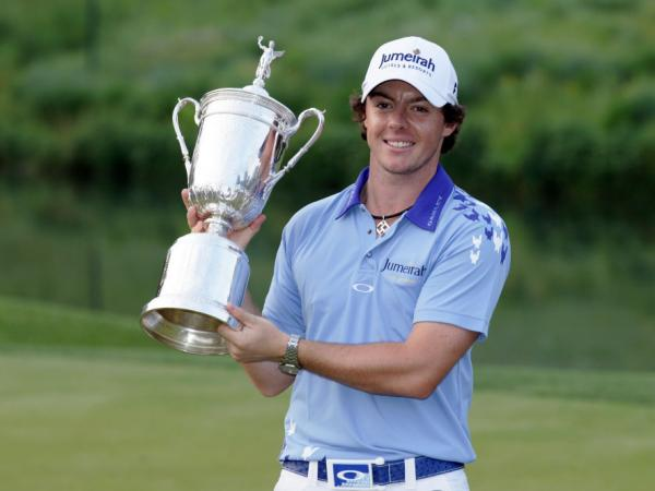 Rory McIlroy poses with his prize after winning the 2011 U.S. Open. Now, the pressure is on him to perform well in the British Open.