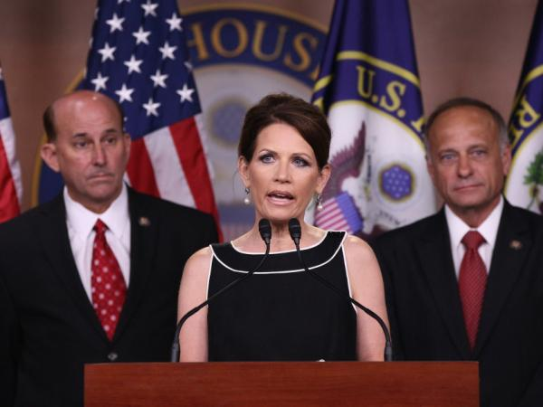 Rep. Michele Bachmann speaks while fellow Republicans representatives Louie Gohmert of Texas (l) and Steve King of Iowa wait.