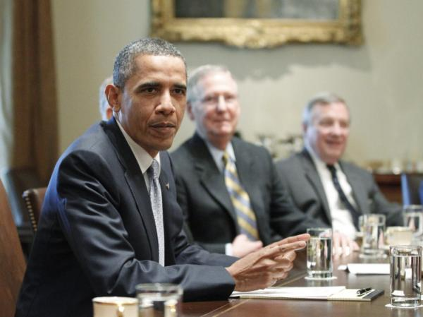 President Barack Obama sits with House Speaker John Boehner (off camera) of Ohio, and Senate Minority Leader Mitch McConnell of Kentucky, and Sen. Dick Durbin, D-Ill., as he meets with Republican and Democratic leaders regarding the debt ceiling in the Cabinet Room of the White House in Washington, Wednesday, July 13, 2011.