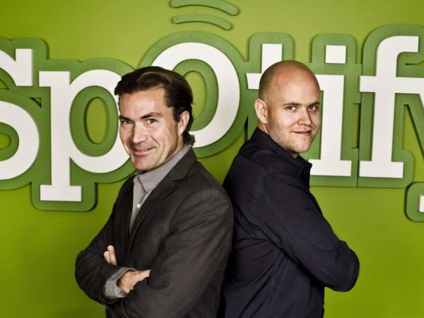 Founders Daniel Ek and Martin Lorentzon pose for a photo in front of the Spotify sign. The company recently announced that it is now available in the U.S.