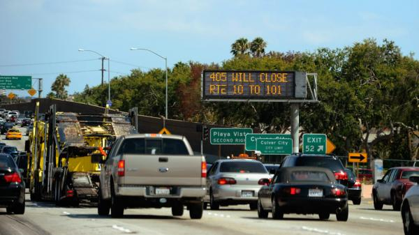 A traffic signs alerts motorists on Interstate 405 of the shutdown.