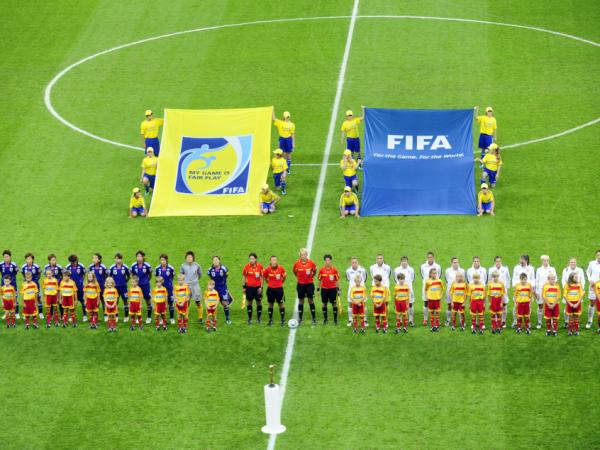 Players of the USA (R) and Japan stand in a line prior to the FIFA Women's Football World Cup final match of Japan vs USA on July 17, 2011 in Frankfurt/M., western Germany.