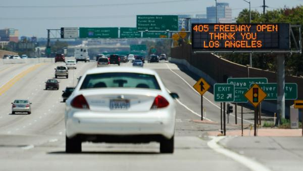 Back on the road: Traffic on a 10-mile stretch of I-405 in Los Angeles started flowing on Sunday, nearly a day earlier than planned.