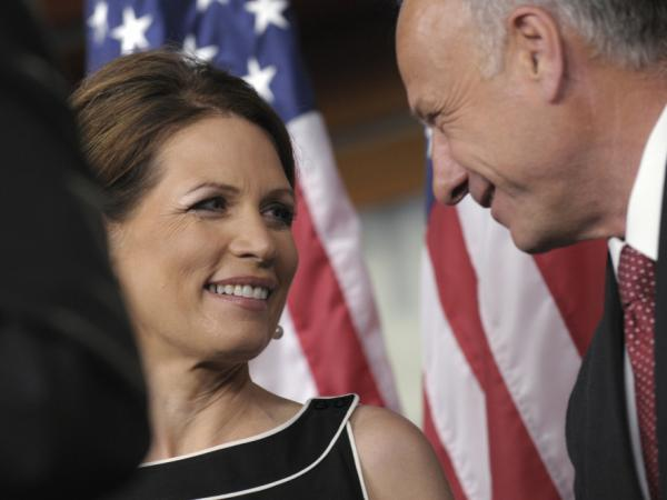 Republican presidential candidate, Rep. Michele Bachmann speaks with Rep. Steve King of Iowa during a news conference on Capitol Hill in Washington on Wednesday.