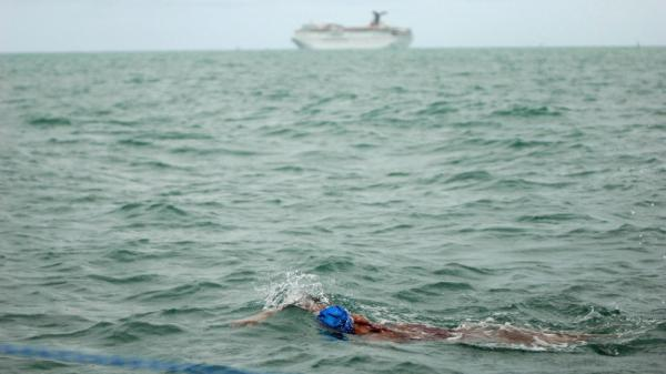 "A cruise ship heads for open waters in the background as Diana Nyad fights the choppy water during a training swim. She says the focus needed for the swim has been  unlike anything in her life.  ""I'll just keep swimming until I see land  and get out.  You've got to want to do something like this."""