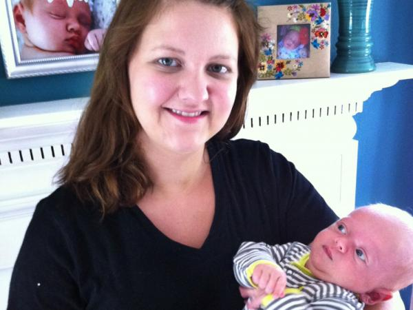 Caroline Nagy and her now eight-week-old infant in Youngstown, Oh. Nagy says she induced labor early at 39 weeks because she was uncomfortable and felt like she was neglecting her other child.