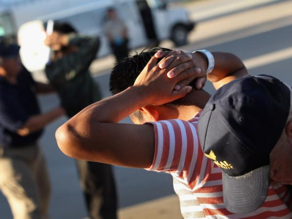 Illegal immigrants from Guatemala are body searched before boarding a deportation flight on June 24, 2011 in Mesa, Arizona. Each month the U.S. Immigration and Customs Enforcement agency sends thousands of undocumented immigrants back to Guatemala. Many have been caught by in the Secure Communities data-sharing program.