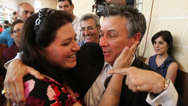 "Nationalist MP Jeffrey Pullicino Orlando, right, celebrates the victory of the ""yes"" camp with yes movement chairman Deborah Schembri in the non-binding referendum to legalise divorce in Malta at a polling station in Valetta in May."