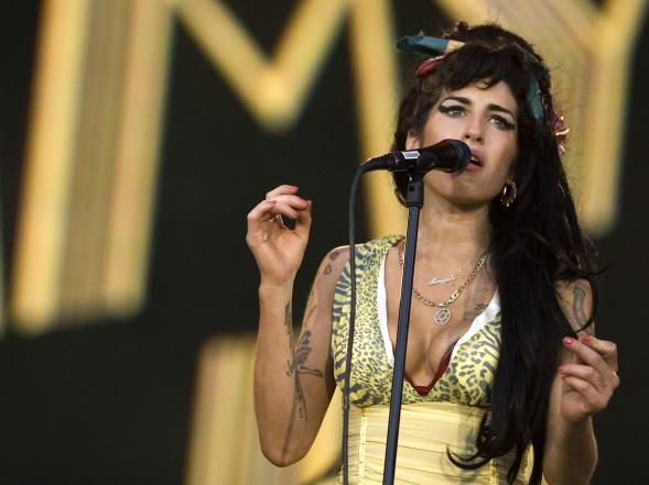 In this July 4, 2008 file photo, singer Amy Winehouse of England performs during the Rock in Rio music festival in Arganda del Rey, on the outskirts of Madrid. British police say singer Amy Winehouse was found dead at her home in London on Saturday, July 23, 2011. The singer was 27 years old.