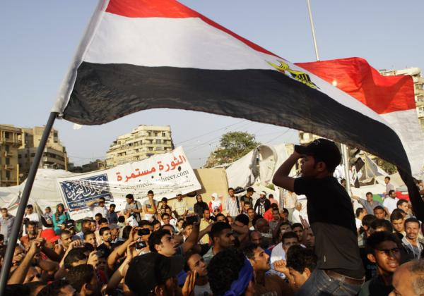 Protesters in Cairo's Tahrir Square shout slogans against Egypt's military rulers on Sunday. Six months after political upheaval led President Hosni Mubarak to step down, activists say reform has stalled.