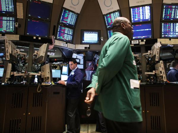 Traders work on the floor of the New York Stock Exchange in April. The country's credit rating could suffer if Congress fails to address the nation's long-term debt.