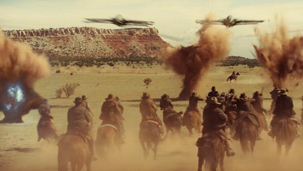 <strong>A Western Shootout — With Spaceships:</strong> Space invaders take on the Wild West in Jon Favreau's genre-crossing <em>Cowboys & Aliens</em>.