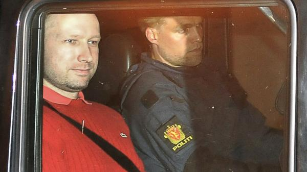 Bomb and terror suspect Anders Behring Breivik leaves the courthouse  in a police car  in Oslo on July 25.