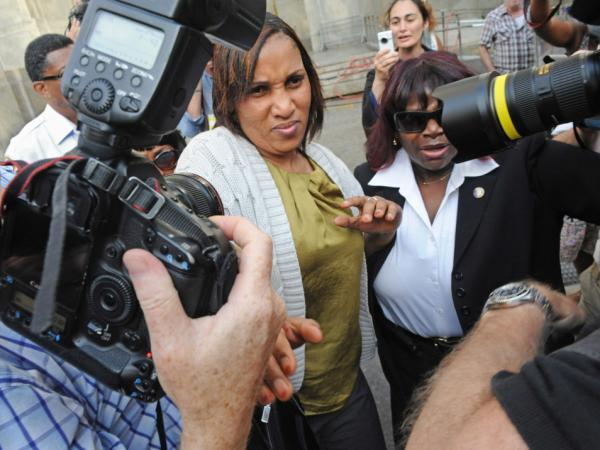 Nafissatou Diallo leaves Manhattan criminal court surrounded by a crush of photographers, Wednesday, July 27, 2011, in New York. Diallo, the hotel maid who accused Dominique Strauss-Kahn of sex assault met with prosecutors Wednesday morning for the first time since the district attorney's office publicly announced it had doubts about her credibility.