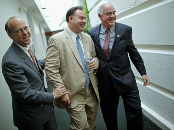 Rep. Greg Walden (R-OH) (L) and Rep. Patrick Meehan (R-PA) (R) pretend to twist the arms of Rep. Frank Guinta (R-NH), July 29. 2011.