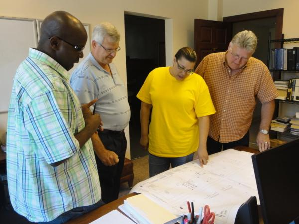 Daphne Wilson (center) and her engineering team review plans for project at Mitchell International Airport in Milwaukee, Wis.