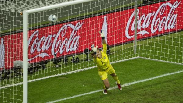 Team USA's Goalkeeper Hope Solo fails to save Japan's defender Saki Kumagai's goal during the FIFA Women's Football World Cup final match Japan vs. USA on July 17, in Germany. Japan won 3-1 in a penalty shoot-out after the final finished 2-2 in extra-time.