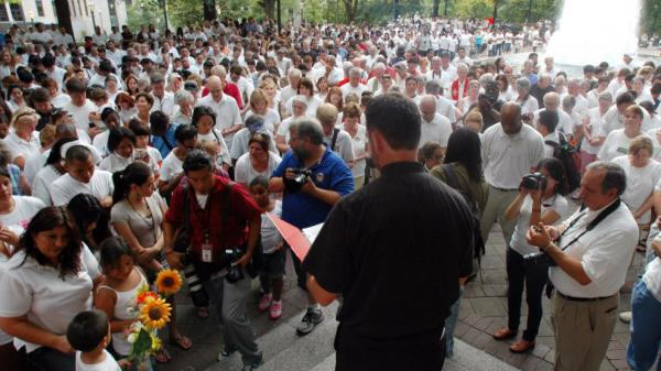 In this June 25, 2011 file photo, participants bow their heads in prayer during a demonstration to protest Alabama's new law against illegal immigration, in Birmingham, Ala.