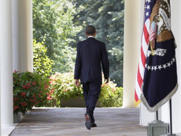 President Barack Obama walks back to the Oval Office after speaking in Rose Garden of the White House, Aug. 2, after the Senate passed the debt ceiling legislation.
