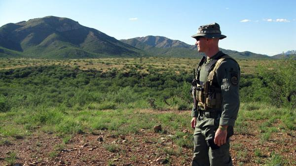 Robert Kiernan, a Border Patrol Search Trauma and Rescue agent, scans for signs that people have been in the area.