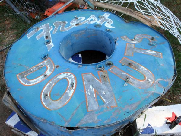 The original sign for Dude's Daylight Donuts had hung on Main Street in Joplin for decades. Here it sits in the public works yard.