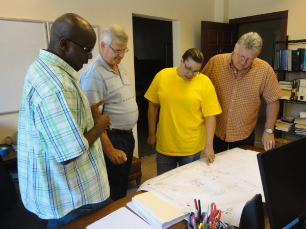 Daphne Wilson, center, and her engineering team review plans for controls systems at Mitchell International Airport in Milwaukee.