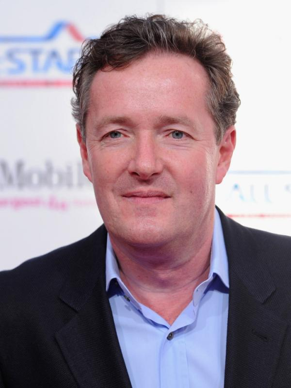 CNN's Piers Morgan is under growing pressure to return to the U.K. to face questions about whether the <em>Daily Mirror </em>engaged in hacking voicemails while he was editor.