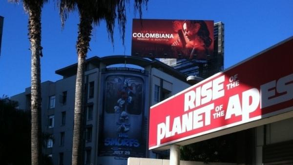 Signs of a battle: Smurfs and apes spar with an upcoming movie, Columbiana, outside LA's ArcLight Hollywood theater.