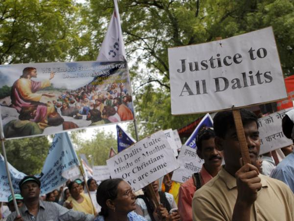 "Dalit Christians, or India's lowest-caste ""untouchables"" who converted to Christianity, hold placards as they march to the Indian parliament in New Delhi, India, Thursday, July 28, 2011. The protesters demanded that the government reclassify them as members of the lowest caste, allowing them to benefit from government quotas in higher education and government jobs."