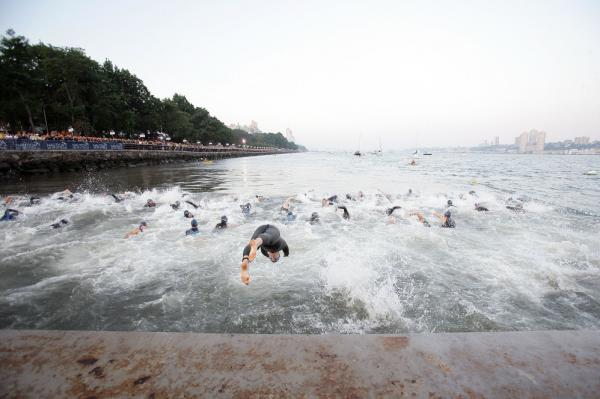 Triathletes begin the 1,500-meter swim (just under 1 mile) in the Hudson River as part of last year's New York City Triathlon. Two race participants died during this year's swim portion.
